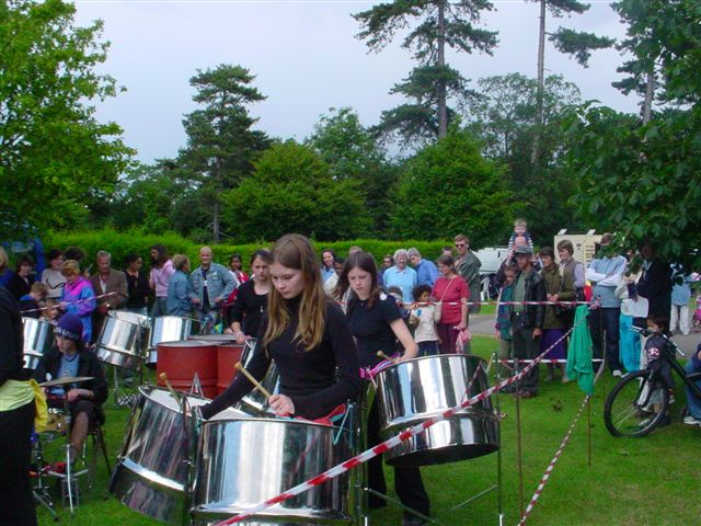Performing in Bedford Park in the rain.
