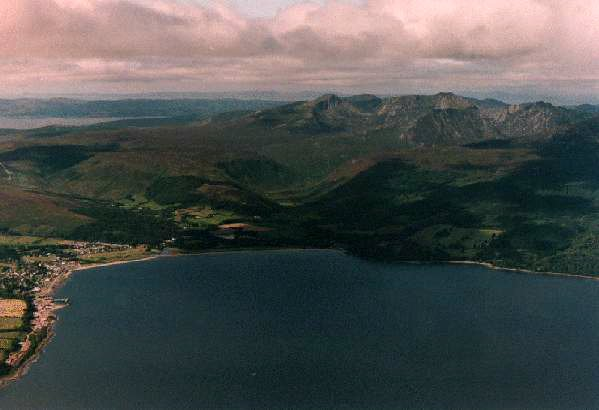 The highest peaks of Arran maintained their glaciers throughout the ice age. As the main scottish ice caps retreated , Arrans mountains maintained their own glacier. The hard volcanic rocks of the Arran mountains were eroded slowly to produce a sharply defined glaciated landscape. This photograph lo...