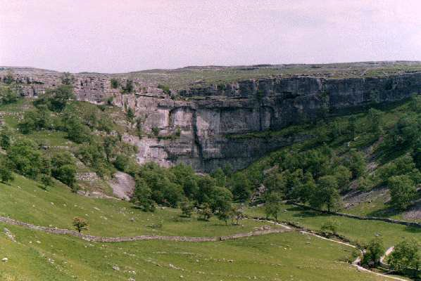 Malham Cove and Tarn are located in the Yorkshire Dales National Park and are part of the Pennine Hills. Around Malham, these hills consist mainly of Carboniferous Limestone.