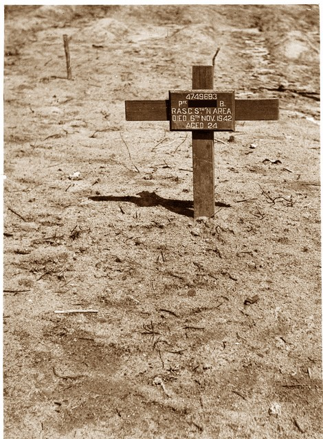 The grave of the soldier (Bernard) at Woodlands Military Cementry,  who died aged 24 years on the 6/11/42. Taken by Wing Commander Knapp and the air force photography 2/6/46.  The cross was later replaced with a stone.  Bernard was one of many thousands who died during the far east campaign. This is...