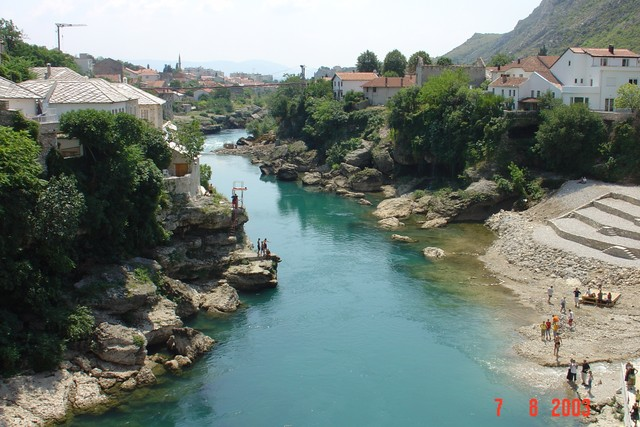 "Mostar is situated on the Neretva river.  The name Mostar comes from the Old Bridge (Stari Most) that crossed the river and the towers on its sides, ""the bridge keepers"" (mostari)."