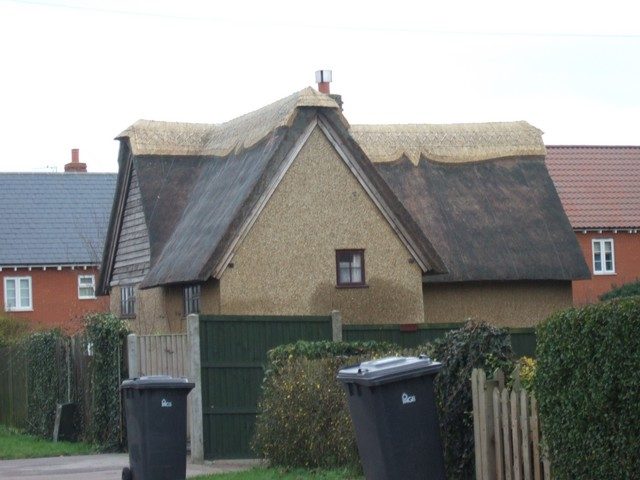 This picture shows a cottage roof been re-thatched in Flitwick, Bedfordshire.