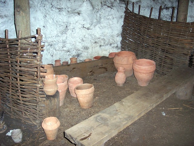 In the house there are examples of the types of pots that were made and used at the time. The pots in this house have been constructed using archeaological evidence. Picture taken on 6th August 2006 at Flag Fen, Cambridgeshire.