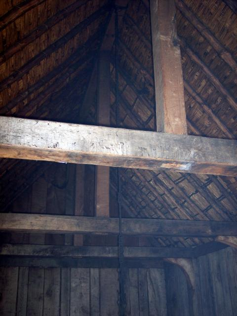 Reconstructed roof of the Hall. This picture shows the roof from the inside. Hazel batons sit on ash rafters to provide support. Willow withers help keep the hazel batons apart.  The upper hidden layers of thatch consist of Rye, heather and an upper layer of Rye.