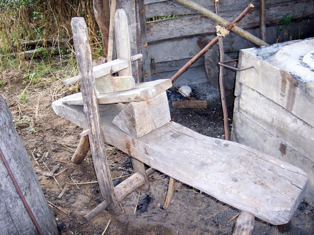 The pole-lathe was used to make wooden cups and bowls and tool handles.  People used their feet to turn the wood whilst it was shaped with a cutting tool held in the hand. Picture taken at West Stow, Suffolk 2006.