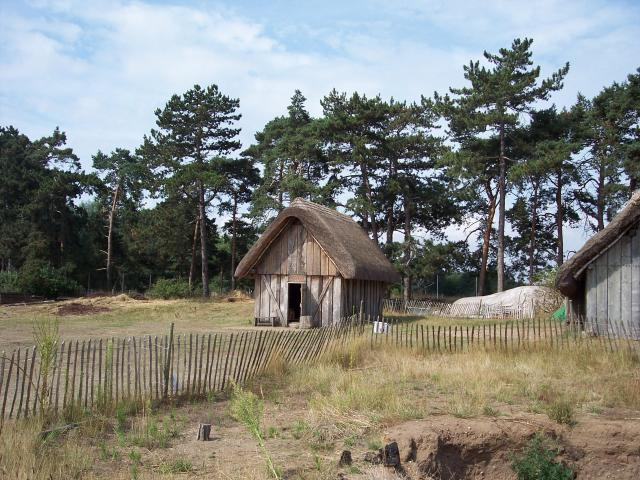 The Anglos and Saxon were two of the groups of warrior farmers who crossed the North Sea into Britain from around 400AD onwards. They set up farms and small villages like this one that has been reconstructed at West Stow in Suffolk. The village was built on a low hill by the river Lark. Picture take...