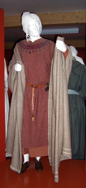 Wealthy women could wear fine clothes and jewellery and the men weapons.  Most families however had to make do with simpler things.  This display at West Stow museum attempts to reconstruct what Anglo-Saxon women would have worn. Picture taken 2006.