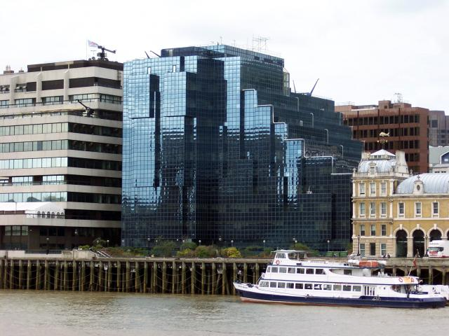 Buildings along the North Bank in the City of London. The City of London is  now Europe's largest CBD and financial district. It is often referred to as just the City or as the Square Mile, as it is approximately one square mile. It is bordered by the City of Westminster in the West and the London b...