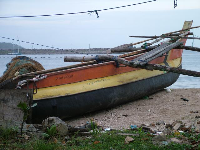 A fishermans boat on a beach near Galle in Southern Sri Lanka.
