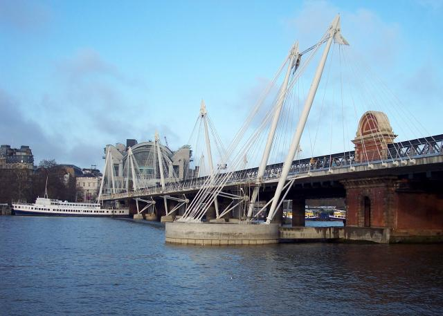 The Hungerford Bridge also known as Charing Cross Bridge lies between Waterloo Bridge and Westminster Bridge. It is a steel truss railway bridge crossing the Thames. At each side of the bridge are cable-stayed pedestrian bridges that share the railway bridge's foundation piers, and are known as the ...