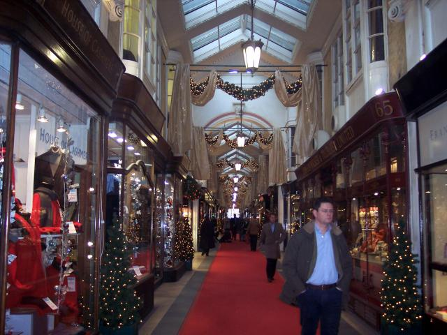 The Burlington Arcade is a covered shopping arcade linking Bond Street, Piccadilly to Burlington Gardens. The Arcade opened in 1819 an early example of a covereed arcade and forerunner of the mid-19th century European shopping galleries and the modern shopping centre. The single straight walkway was...