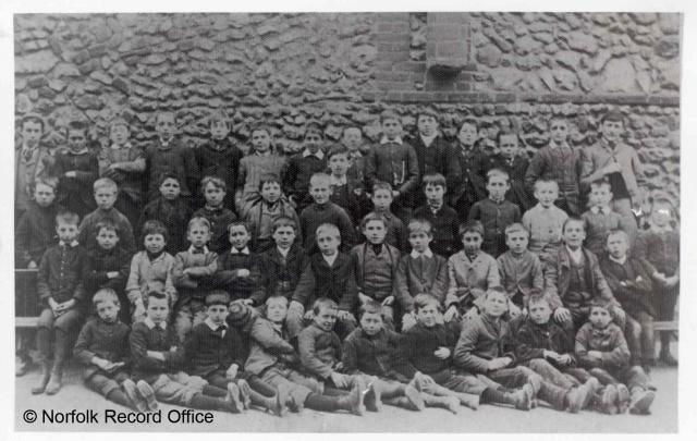 This is taken in the same style as school photographs today. Note all the children are boys. 