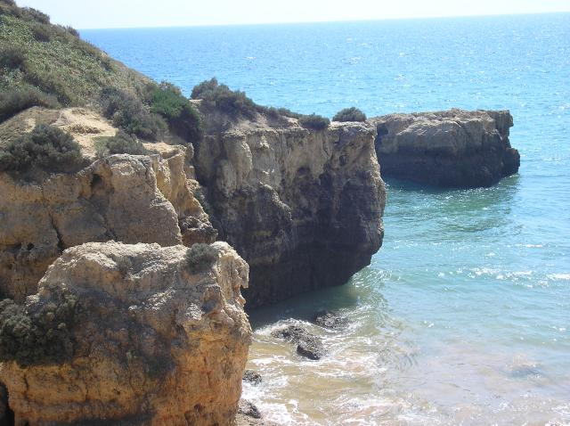 These pictures show some of the cliff faces along the beaches at Albfeira in the Algarve region of Portugal. They clearly show how the soft sandstone is easily erdoded by wind, rain and wave action in some cases creating free-standing sandstoe pillars.