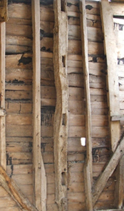Detail of the timber framed construction of a barn in Shelton, NHER 39829. Can you use straight lines to produce a repeating pattern like this? Copyright Norfolk Museums & Archaeology Service.