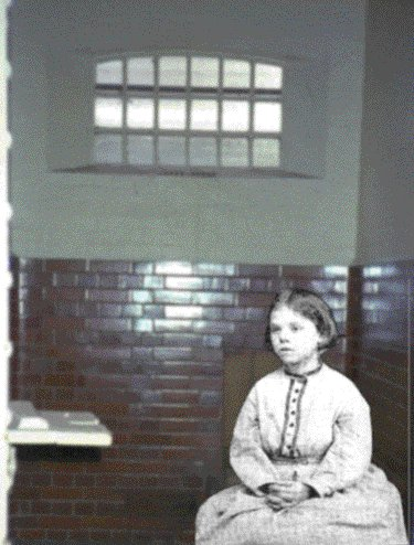 This picture is a composite formed by overlaying the original black-and-white photograph of Julia onto a modern colour photograph of a cell in the gaol.