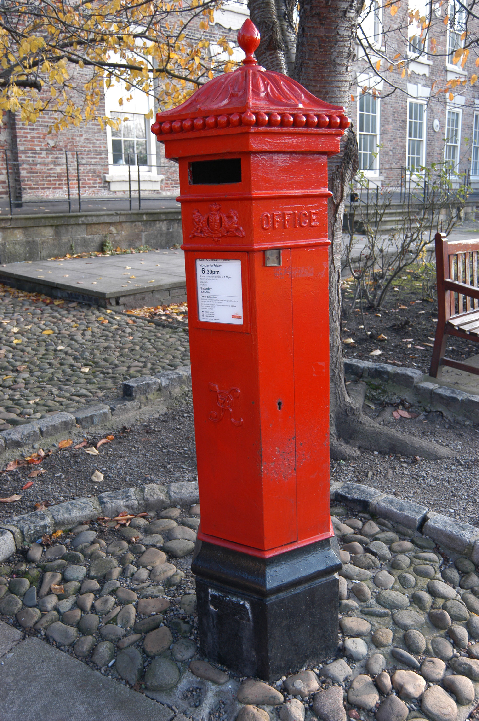"Victorian Pillar Box. Durham, Cathedral grounds, 2005.  The letters VR on it stand for ""Victoria Regina"" which is Latin for ""Queen Victoria""."
