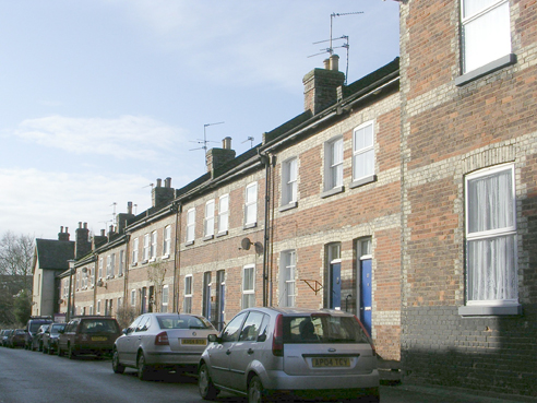 Melton Street, Melton Constable, NHER 13583. These homes are all joined together - these are called terraced houses. Do you live in a terraced house? Copyright Norfolk Museums & Archaeology Service.
