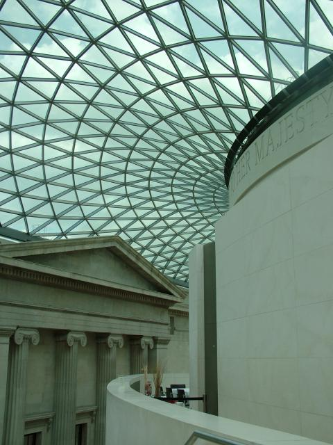 The Great Court at the British Museum in London showing the glass roof structure. The Great Court was opened in December 2000. The glass roof covers what was once the open-air inner courtyard. The world-famous Reading Room is at the centre. The Great Court is the largest covered public square in Eur...
