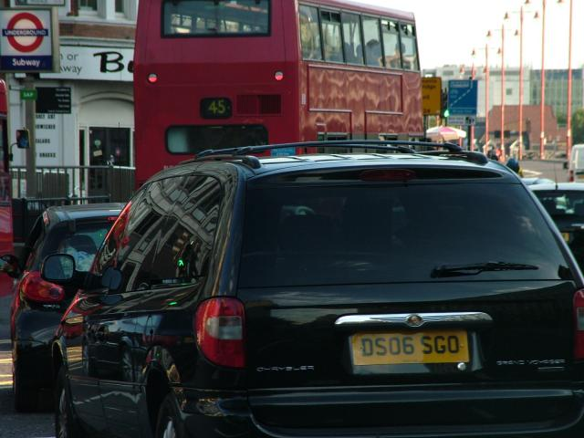 Traffic waiting to cross the Thames at Blackfriars Bridge, London at the evening rush-hour.