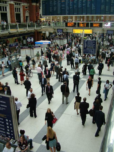 The passenger concourse at Liverpool Street Station in London at evening rush-hour time. Visible are the train information boards showing the departures and arrivals of trains. This station mainly serves towns and cities on the eastern side of England and trains run on lines out to Norwich, Ipswich,...