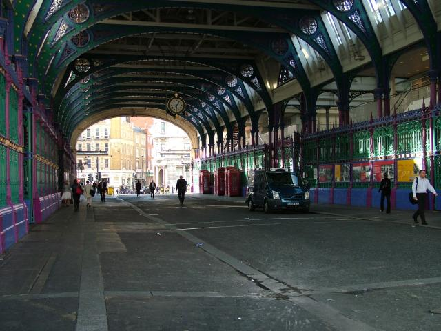 Photos of the outside of, and area around, Smithfield Market, London. Smithfield Market, London's wholesale meat market, most likely takes its name from the 'smooth field' on which it was built.  