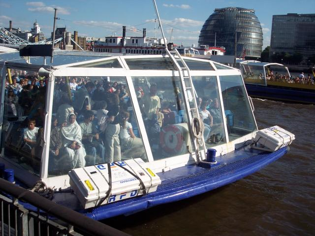 Pleasure boats on the River Thames, London. Passengers can generally board and alight these boats at one of a number of points along the river - Millbank, Westminster, Bankside, Tower of London, Greenwich. A one-way trip between Westminster and Greenwich takes approx 1 hour.