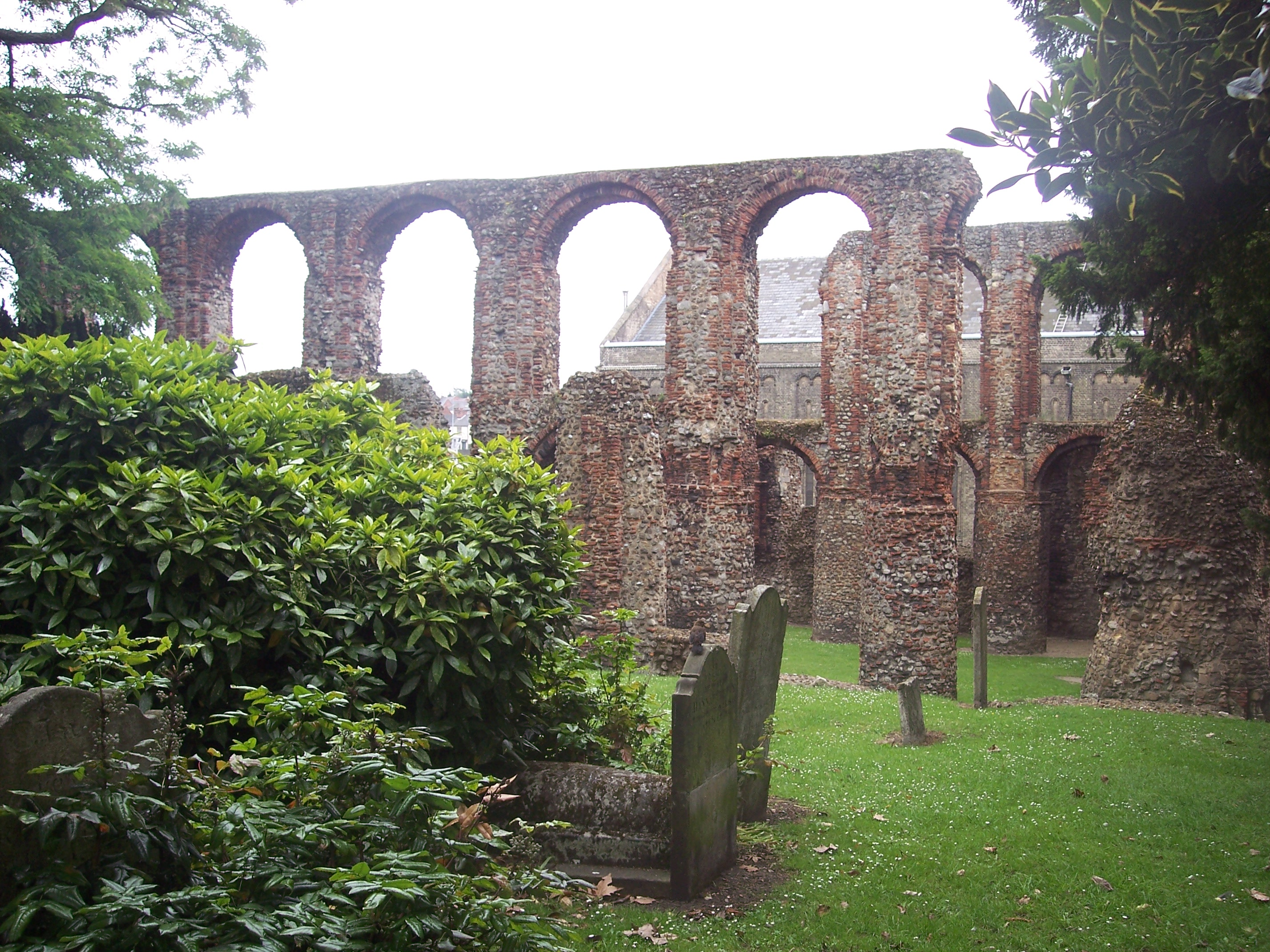 The remains of St Botolph's Priory Colchester, including the arched windows, sturdy circular piers run the length of the nave, and the arcading above is typically Norman. The was built mainly from flint and re-used Roman bricks, this masonry then being completely covered with plaster and possibly pa...