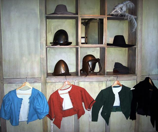 Including a Puritan's black felt hat, a Cavalier's grey felt hat with plume, a Soldier's bonnet (woollen beret), Gunner's cap, Mantaro - a soldier's forage cap, a Tri-bar helmet and a pikeman's pot helmet. Picture taken May 2007 at Cromwell's House Museum Ely.