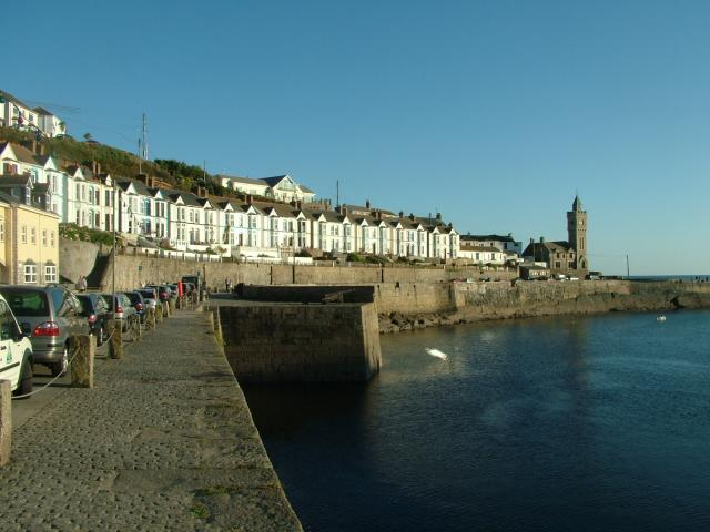 Porthleven is situated on Cornwall's south coast just a few miles from Helston. The harbour was built as a refuge for boats and ships travelling along the rugged and dangerous Cornish coast. The original harbour was built in 1825 and was then taken over by Harvey & Co in 1850 and the current har...