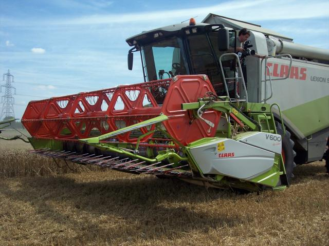 "The combine is crucial for harvesting arable crops. It completes several operations at the same time. It cuts the plant about 9 inches above ground. It is then fed into the heart of the combine where it is spun very fast against a metal grate with holes in it. This is known as ""thrashing""...."