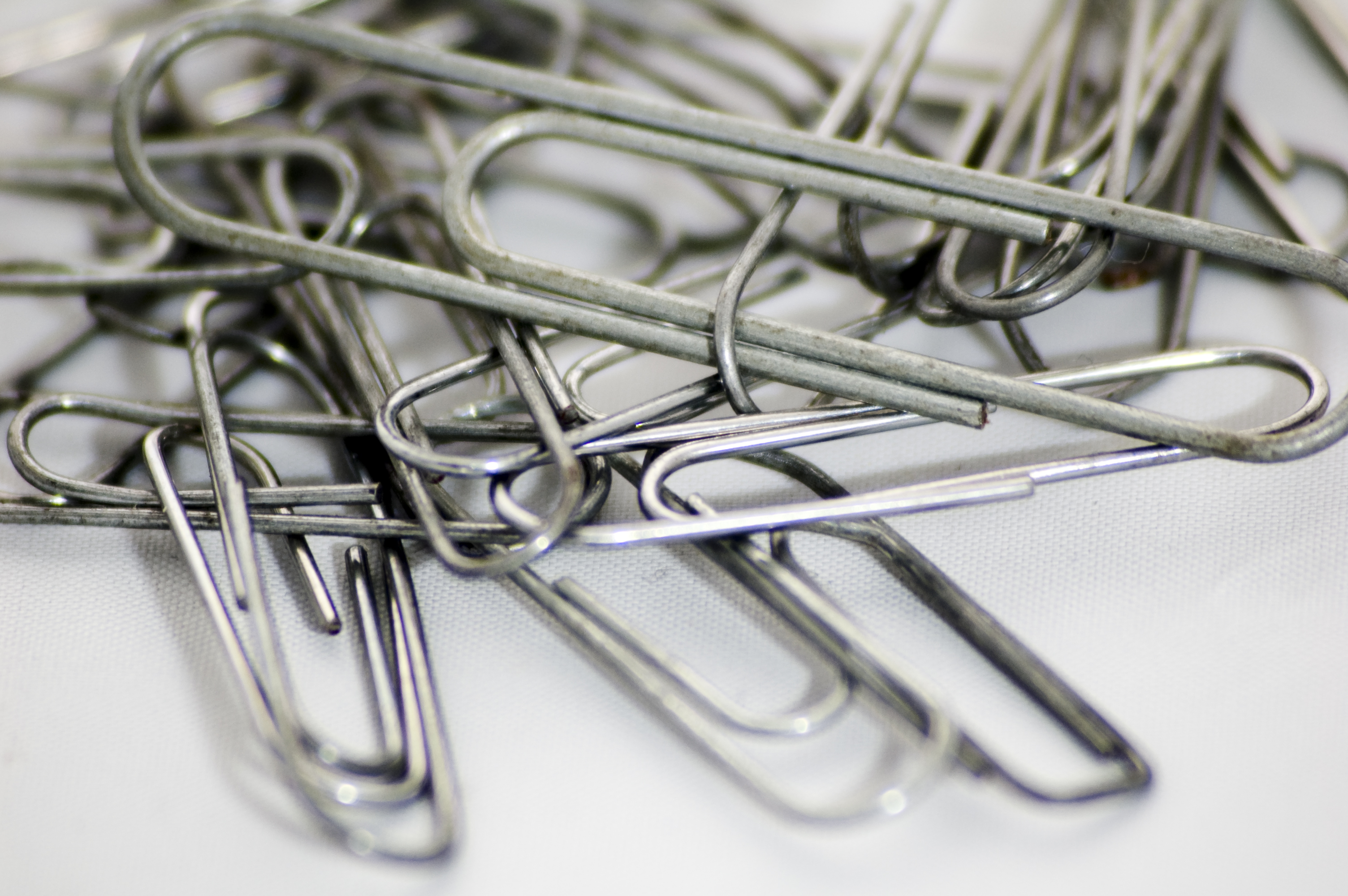 paper clips A paper clip (or sometimes paperclip) is a piece of plastic or metal that is used to hold pieces of paper together.