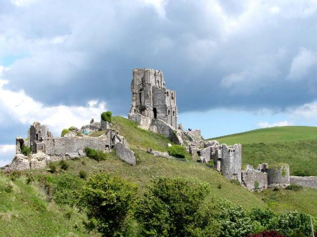 Corfe Castle commands a gap in the Purbeck hills in Dorset. A castle was first built on the site in the 11th century. In 1646, following a siege by Parliamentarians, it was partly destroyed. It is now owned by the National Trust.