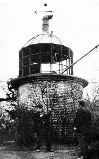 This is believed to be a final record photograph of this prominent landmark taken just before its demolition about 1920. The small lighthouse at the summit of Beacon Hill has an interesting history, having been erected, together with an adjoining house, in 1829 by The Corporation of Trinity House, i...
