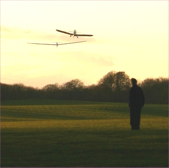 Aerotow take-off of a glider, towed by a light aircraft tug.