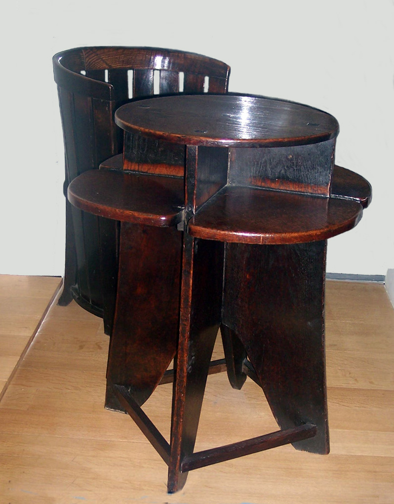 This table and chair came from the Ingram Street Tea Rooms, Glasgow and was designed and made around 1907 by MacKintosh. At this time he was designing some of his most complete buildings and interior schemes for a tea room owned by Kate Cranston. The table and chair can be seen in the Victoria and A...