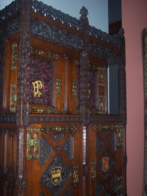 This cabinet was designed by A.W.N. Pugin for his own dining room. It is based on late Medieval cupboards. The elaborate carving is contained within the structural framework. The cabinet is oak carved, painted and gilded with brass fittings and can be seen in the Victorian and Albert Museum, London.