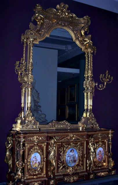 This cabinet can be seen in the Victoria and Albert Museum, London.