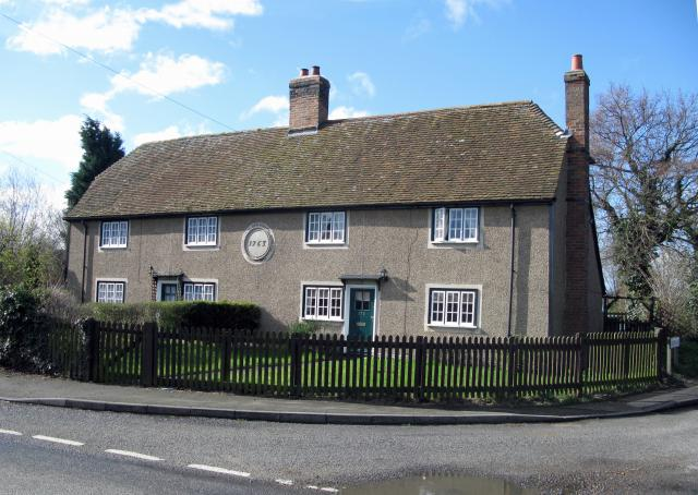 These cottages have been rennovated and the roofs changed since they were first built. Cardington.