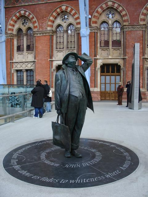 Sir John Betjeman was born in 1906 and died in 1984.  He was famous as a poet, journalist and broadcaster. He became Poet Laureate in 1972.  He had a great love of Victorian architecture and fought to save the entrance to St Pancras station in London. This sculpture now stands inside the station.