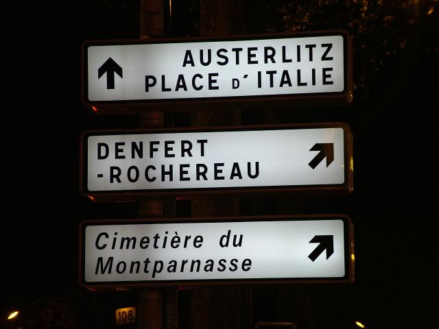 Direction sign in Paris on Boulevard Montparnasse