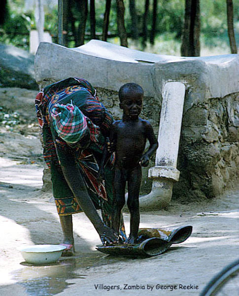 Villagers, Zambia (woman bathing child)