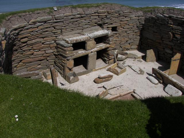 The houses at Skara Brae built into mounds of pre-existing earth middens, to act as insulation against Orkney's harsh winter climate. The houses measure around 40 square metres in size with a large square room containing a hearth for heating and cooking. As few trees grow on the island, the people o...
