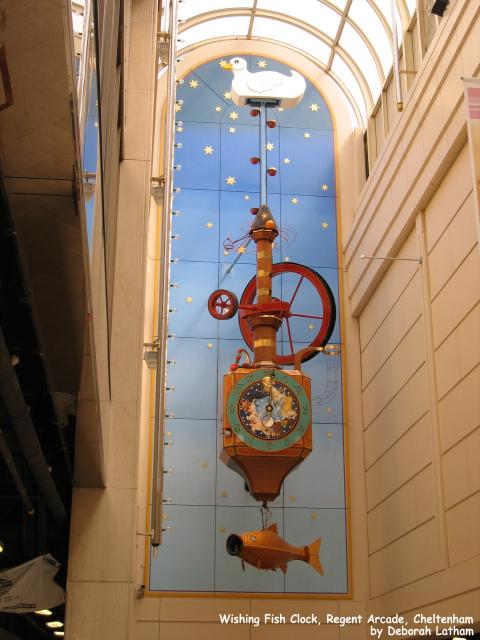 The Wishing Fish Clock was designed by Gloucestershire artist Kit Williams (author of the book 'Masquerade'), and is located in the Regent Arcade, Cheltenham.