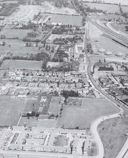 An aerial photograph from 1970, showing where the A13 goes through Pitsea.  What is the large building near the roundabout?  What is there now where the 4 dome-like buildings are?  Where have all the fields gone?