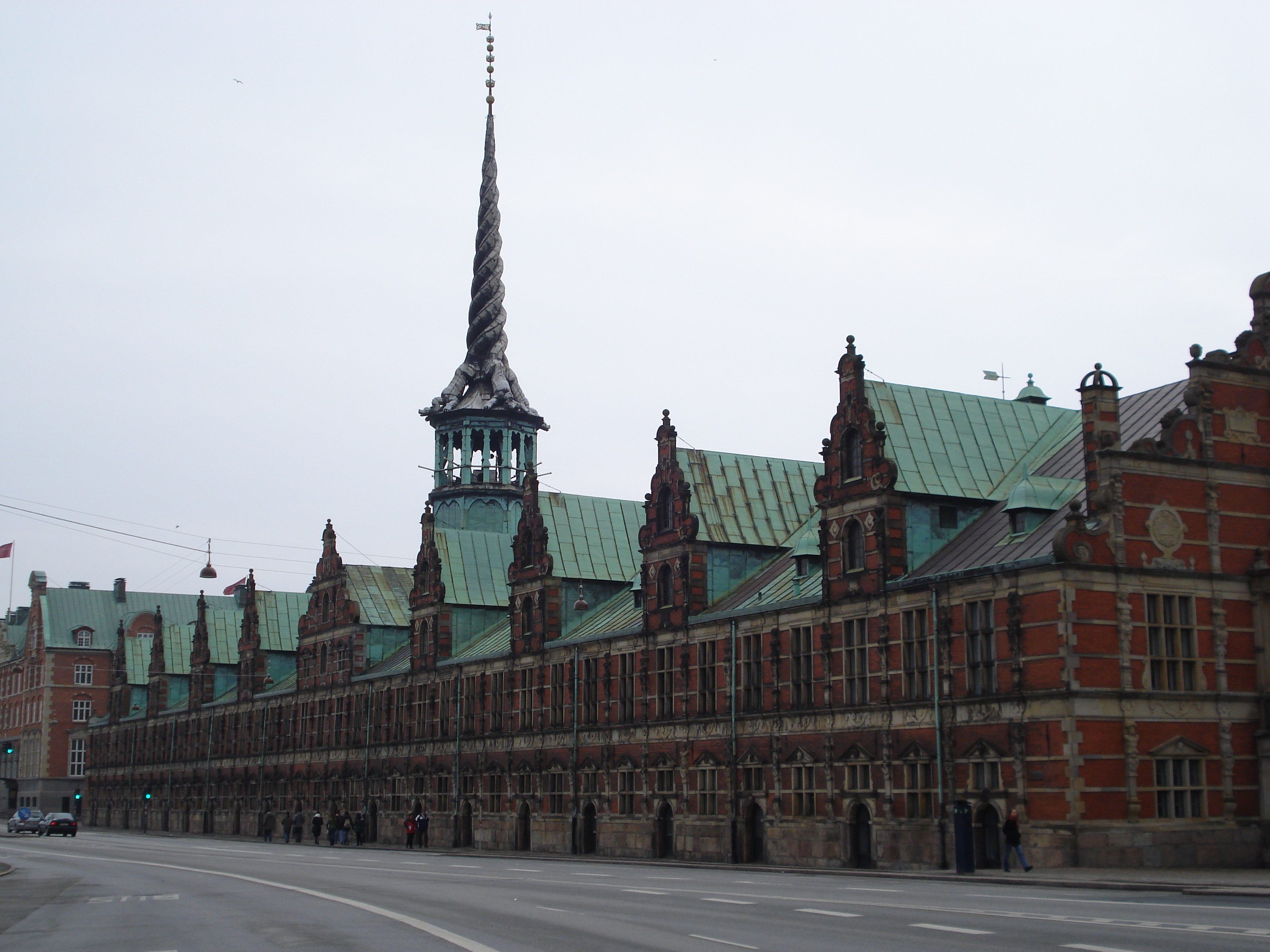 The Stock Exchange was originally a warehouse in Dutch Renaissance style, dating from the early 17th Century. The original building was not grand enough for King Christian IV so in 1625 he commissioned 18 striking gables and a 54 metre high spire made up of four entwined dragons'tails.