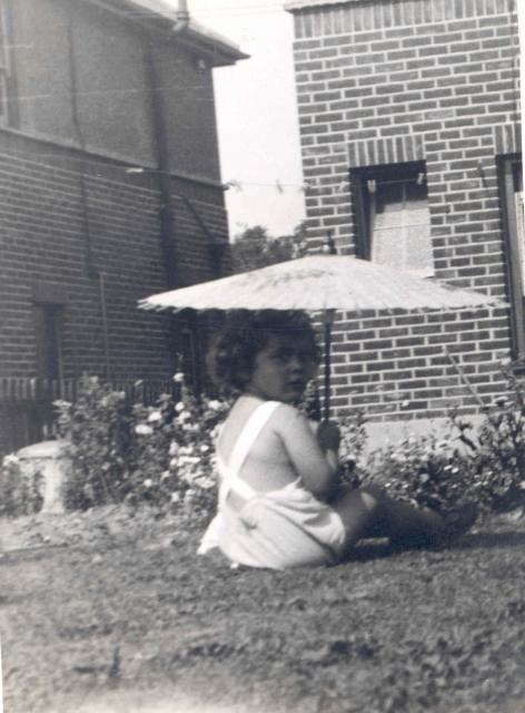 Judy Tomalin, daughter of Inspector Tomalin, in the garden of a police house at Police Headquarters, 1939