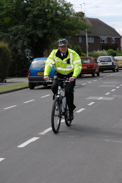 A police constable on duty on a push bike.