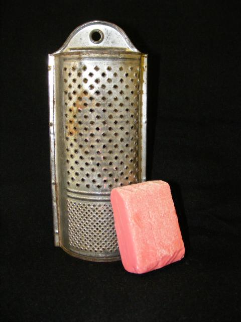 Before the development of modern soap powders and detergents, cothes were washed using blocks of hard soap.  It was grated so that the soap disintegrates into the water.