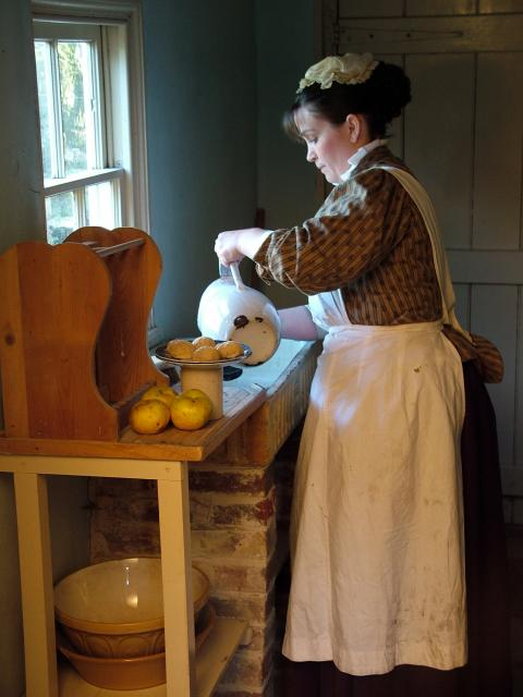 Victorian cook pouring water