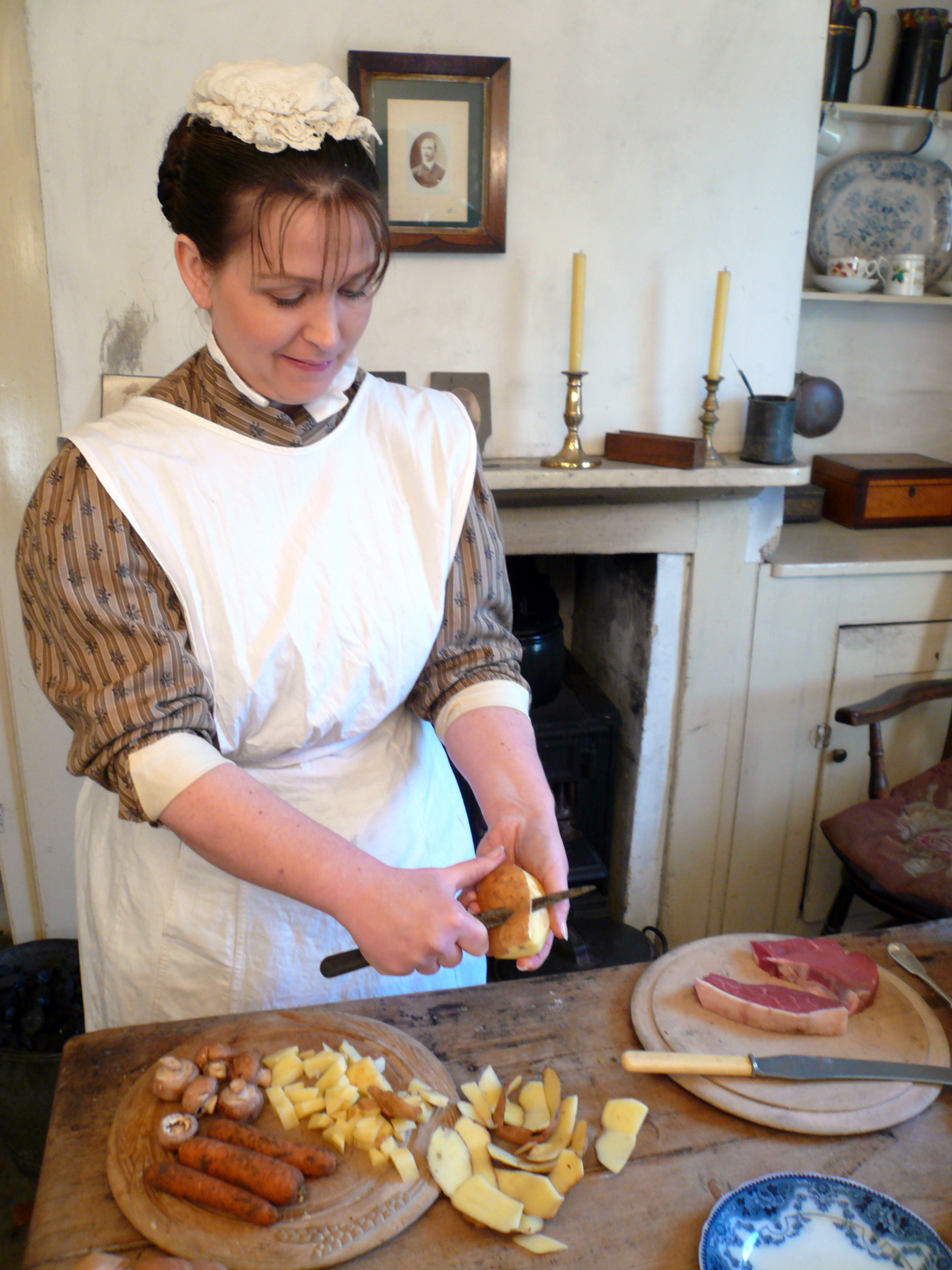 Victorian cook peeling potatoes